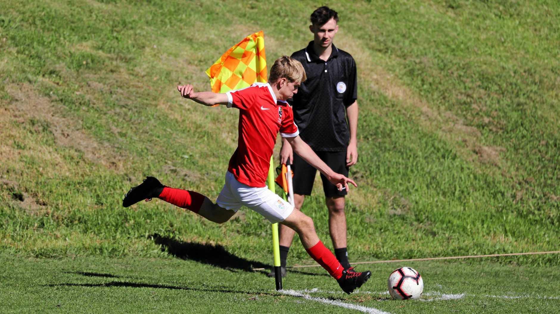 Ipswich Grammar School footballer Elijah Vincent-Tooth prepares to take a corner in his latest GPS match in Toowoomba.