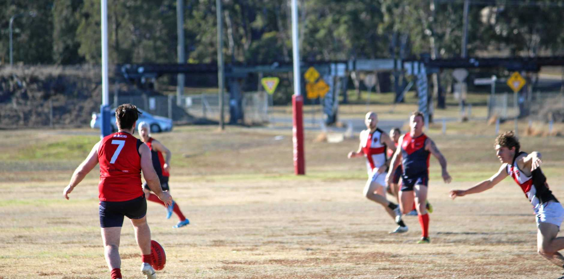 Warwick Redbacks player Kyle Thorn kicks ahead in a Redbacks win at Warwick Credit Union Oval.