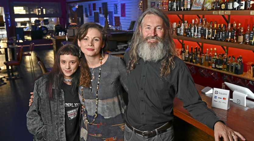 MILESTONE: Banshee's Bar owners Ken and Nina Weaver with employee Rachel Kidd ahead of their first anniversary celebration.