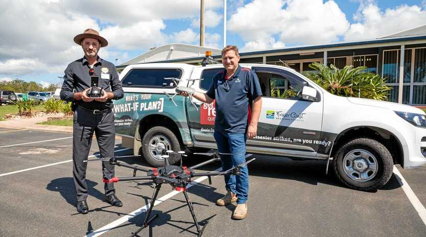 TAKING OFF: TECKnology Managing Director Leslie Lowe and Fraser Coast Regional Council Disaster Planning Coordinator Brendan Guy with one of the drones. The council has engaged TECKnology as the 'chief pilot' to help implement their drone program over the next three months.