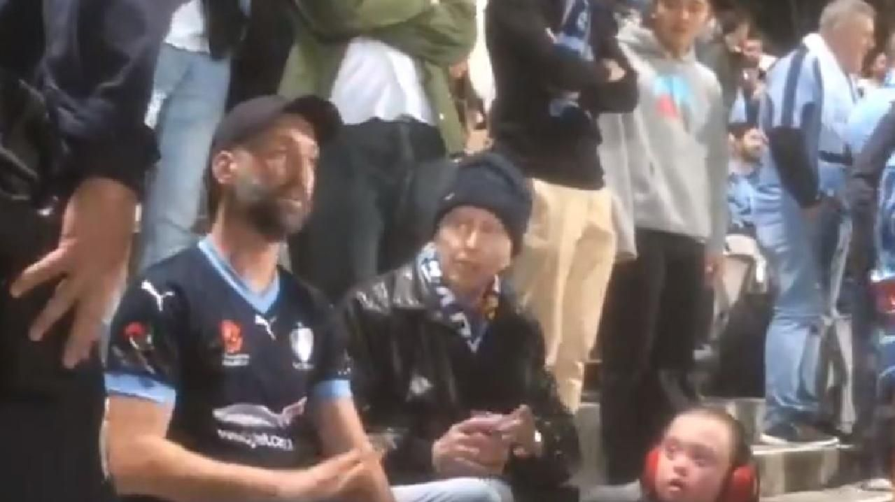 The evicted fan being spoken to by NSW Police officers.