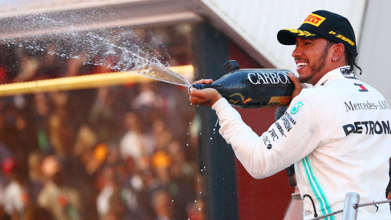 Race winner Lewis Hamilton of Great Britain and Mercedes GP celebrates on the podium after the F1 Grand Prix of Spain. Picture: Dan Istitene/Getty Images