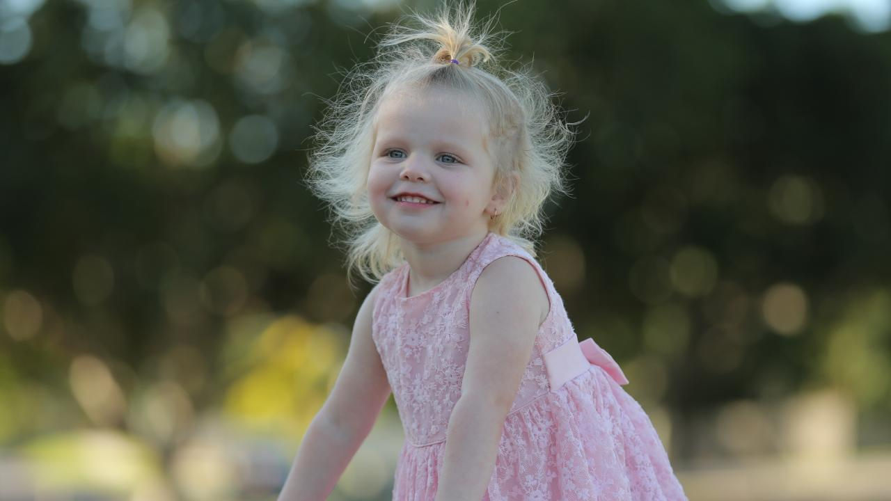 Serenity Parker was taken to hospital with serious burns after falling into a campfire last year. Picture: Mark Cranitch