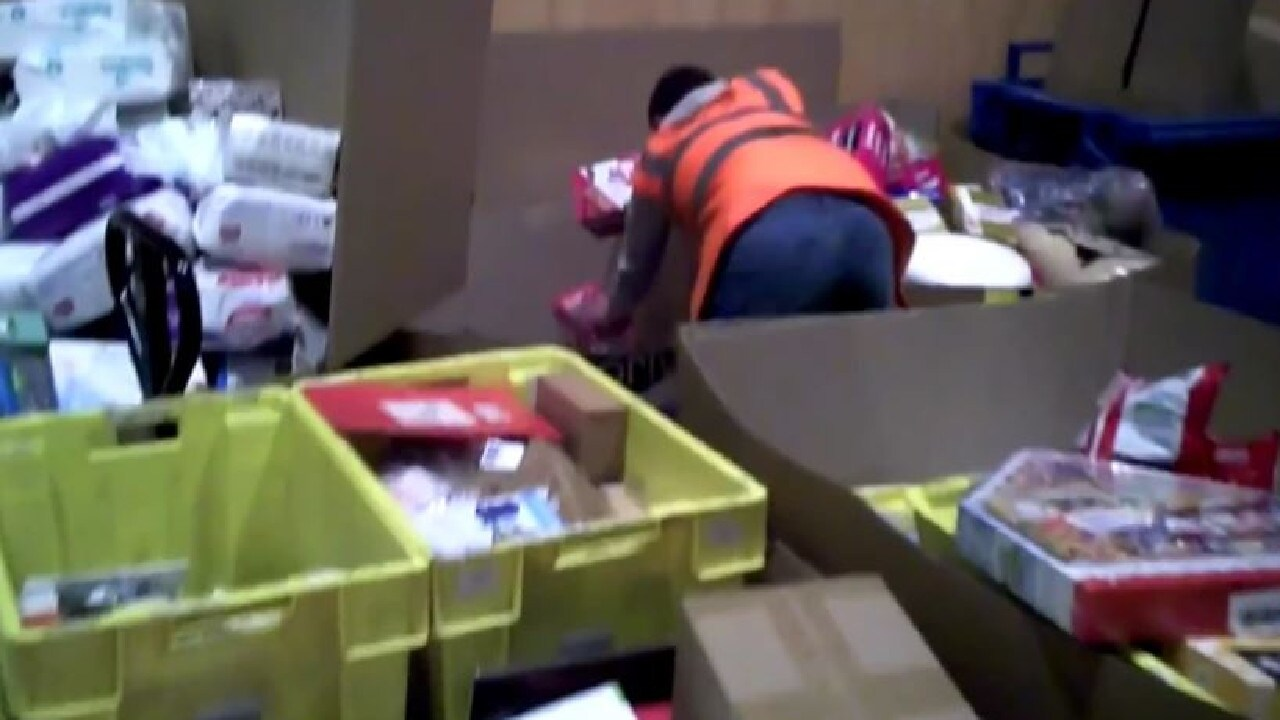 An Amazon worker sorting items in the 'destruction zone' of a warehouse. Picture: RTL.FR