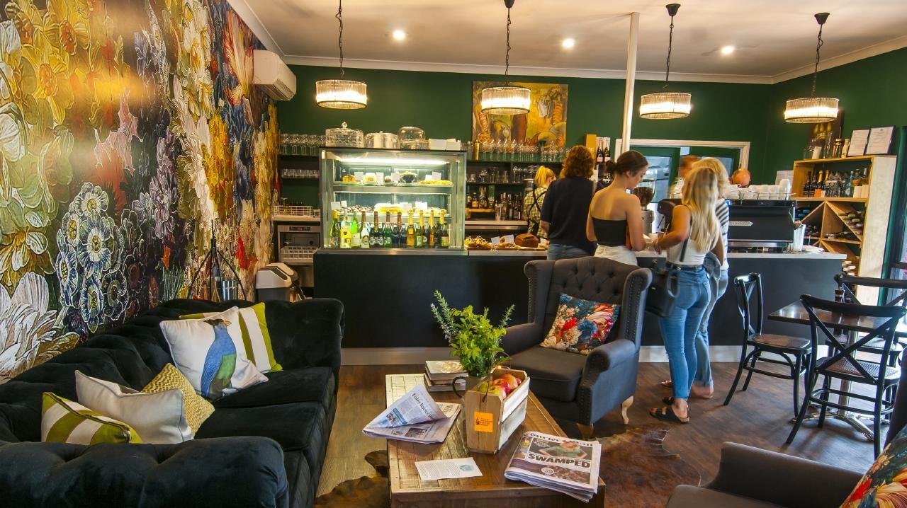 The cosy interior and floral wallpaper at Emeraude. Picture: David Martinelli