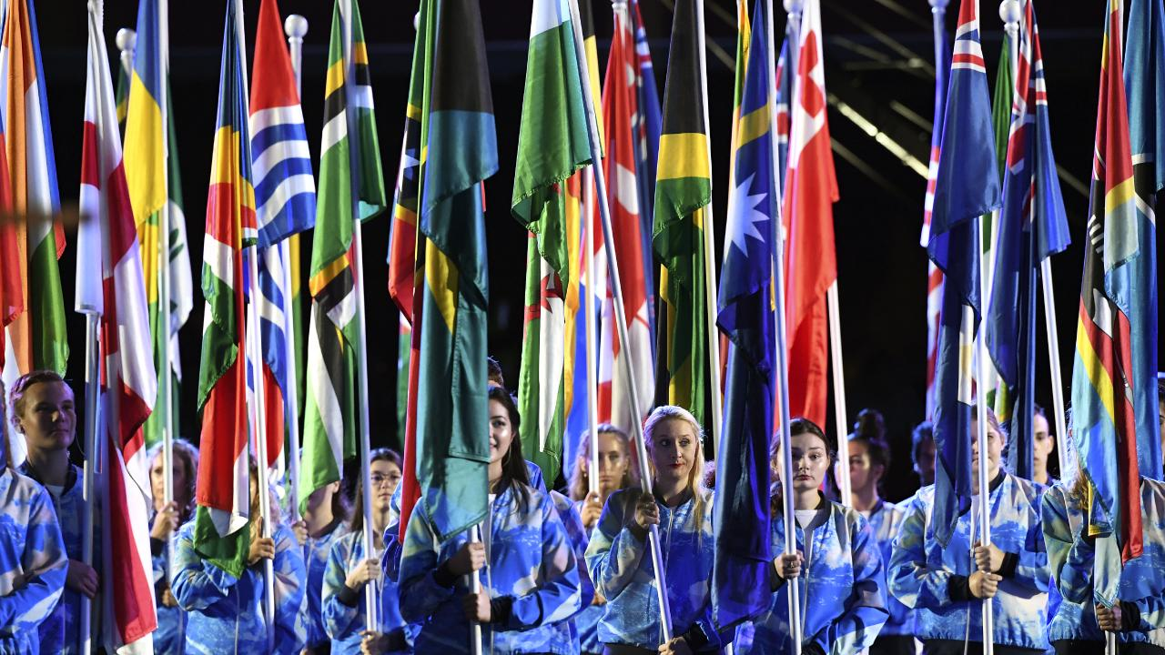 Flag bearers are seen during the Opening Ceremony of the XXI Commonwealth Games at Carrara Stadium, on the Gold Coast. Picture: AP Image/Dean Lewins