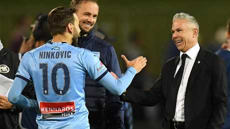 Sydney FC coach Steve Corica (R) has been singled out for special praise by his skipper. Picture: AAP