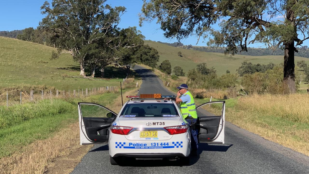 Police search for the shooter at Bingleburra near Dungog. Pictures: Peter Lorimer