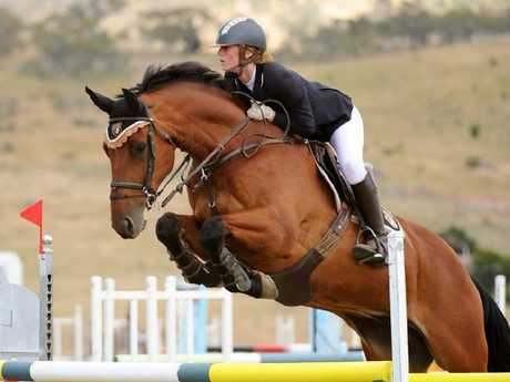 Olivia Inglis' makes a spectacular jump during the second round of the Junior Championships.