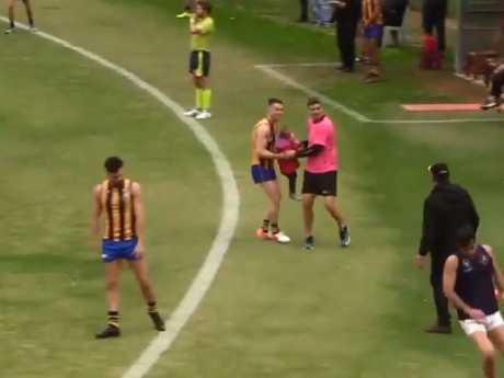 Alex McLeod hands the young girl to the St Bernard's runner.