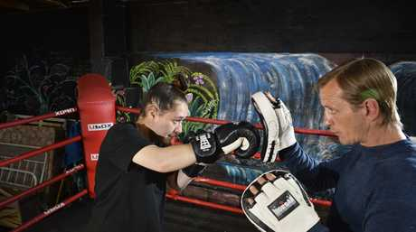 Former Australian champ Mick Shaw works with Moana Flynn as Emerge offer personal training to the public as a means of supporting their social enterprise work, Tuesday, May 14, 2019.