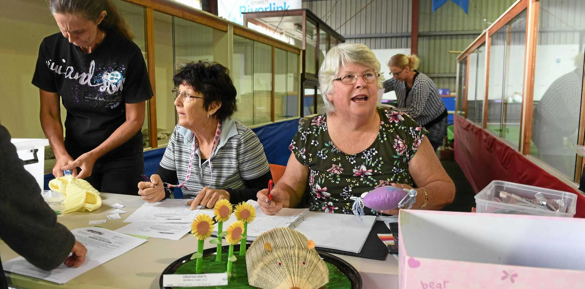 NEXT: Creative Crafts chief steward Pam Lobwein (right) was busy with entries on Monday ahead of judging of the section on Tuesday.