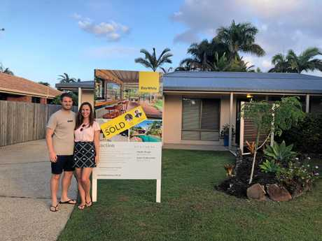 GREAT DEAL: Cherie Ellis, right, bought her first home in Parrearra at auction in April. She's here with her partner, Daniel Peyre.