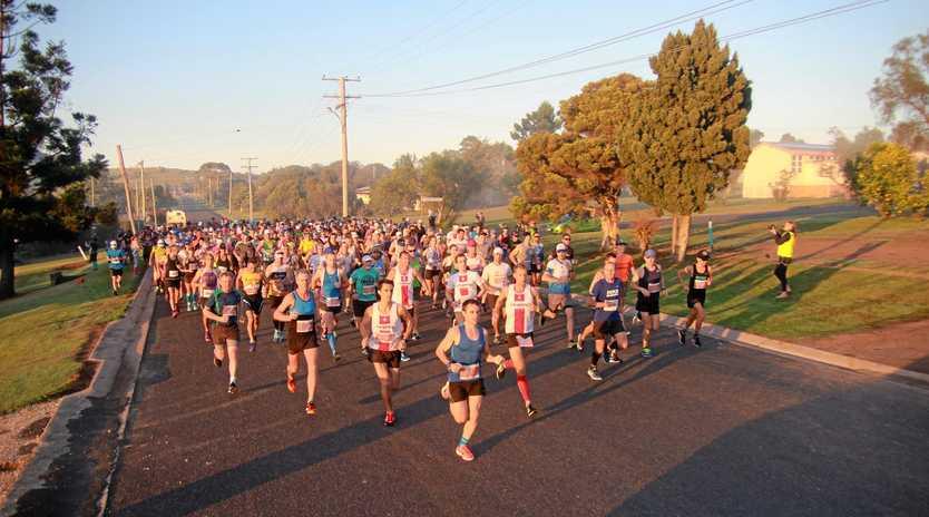 BIG FIELD: Runners leave Cedar St in Killarney in a past Pentath-run heading to Queen Mary Falls.