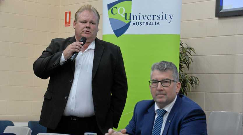 Labor candidate for Hinkler Richard Pascoe speaks as the LNP's Keith Pitt looks on.