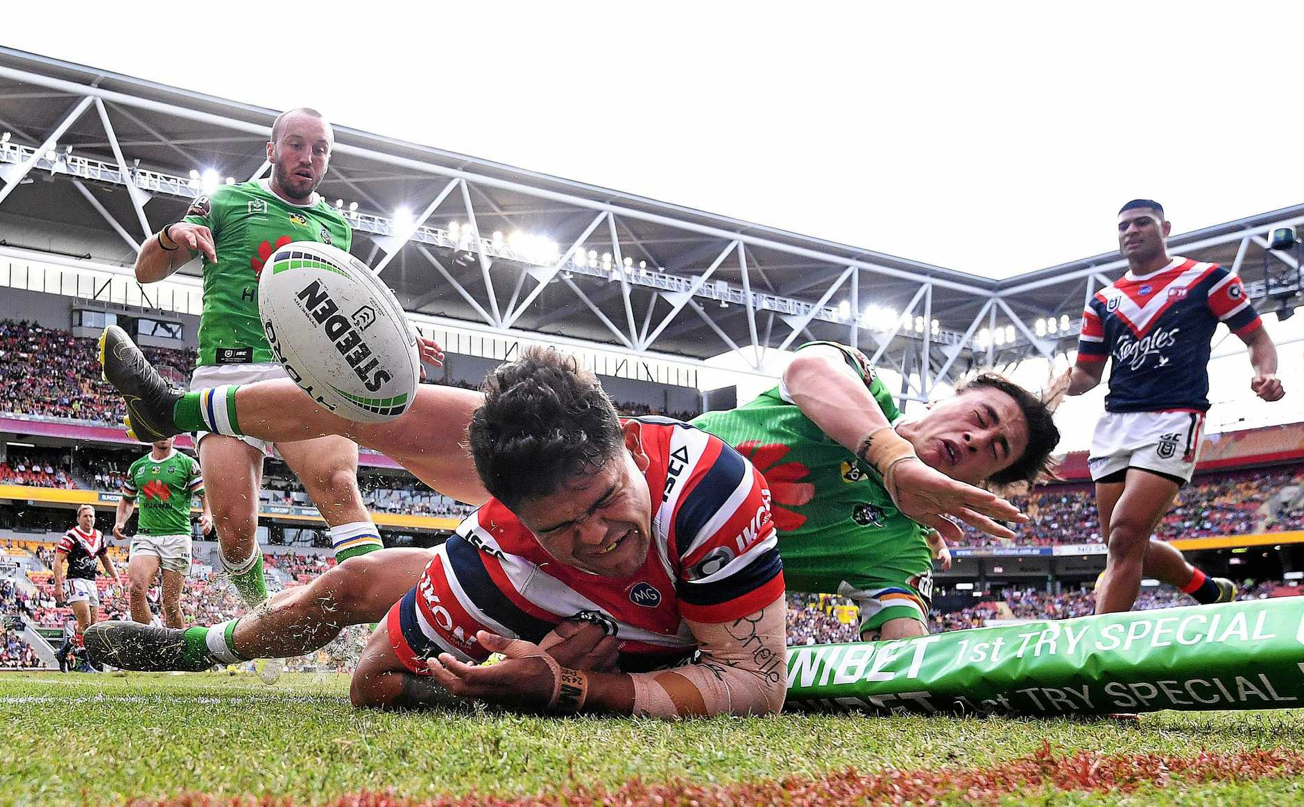 Latrell Mitchell of the Roosters scores a try during the Round 9 NRL match between the Sydney Roosters and the Canberra Raiders at Suncorp Stadium in Brisbane, Sunday, May 12, 2019.  (AAP Image/Dave Hunt) NO ARCHIVING, EDITORIAL USE ONLY