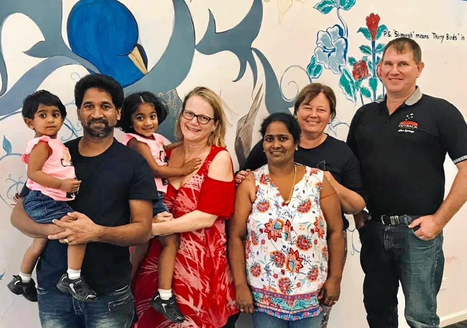Nades and Tharunicaa, Jenny Balaca with Kopika, Priya, Marie and Jeff Austin pictured recently at the Broadmeadows Detention Centre in Melbourne.