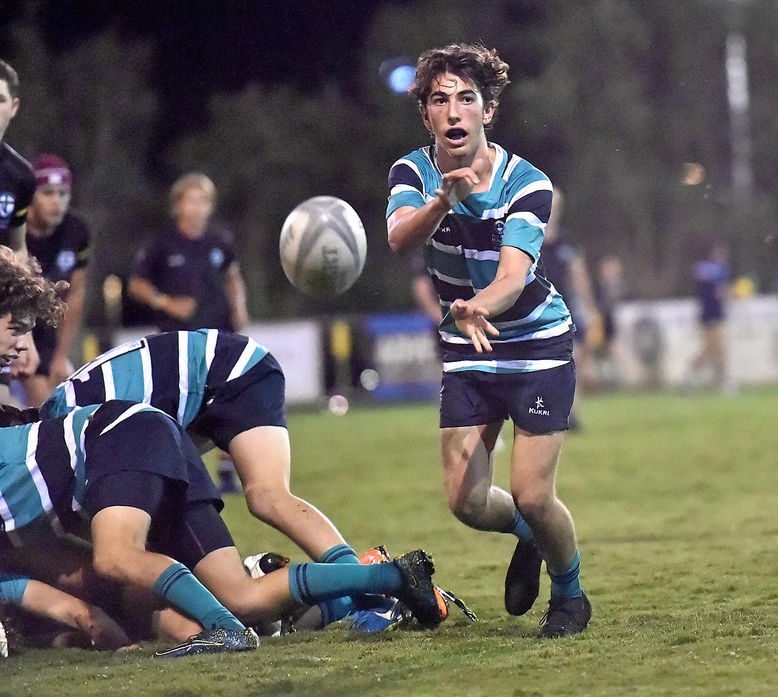 Siena against Matthew Flinders First XV rugby union match last week (May 8). Matthew Flinders player Liam Doherty passes from the scrum.