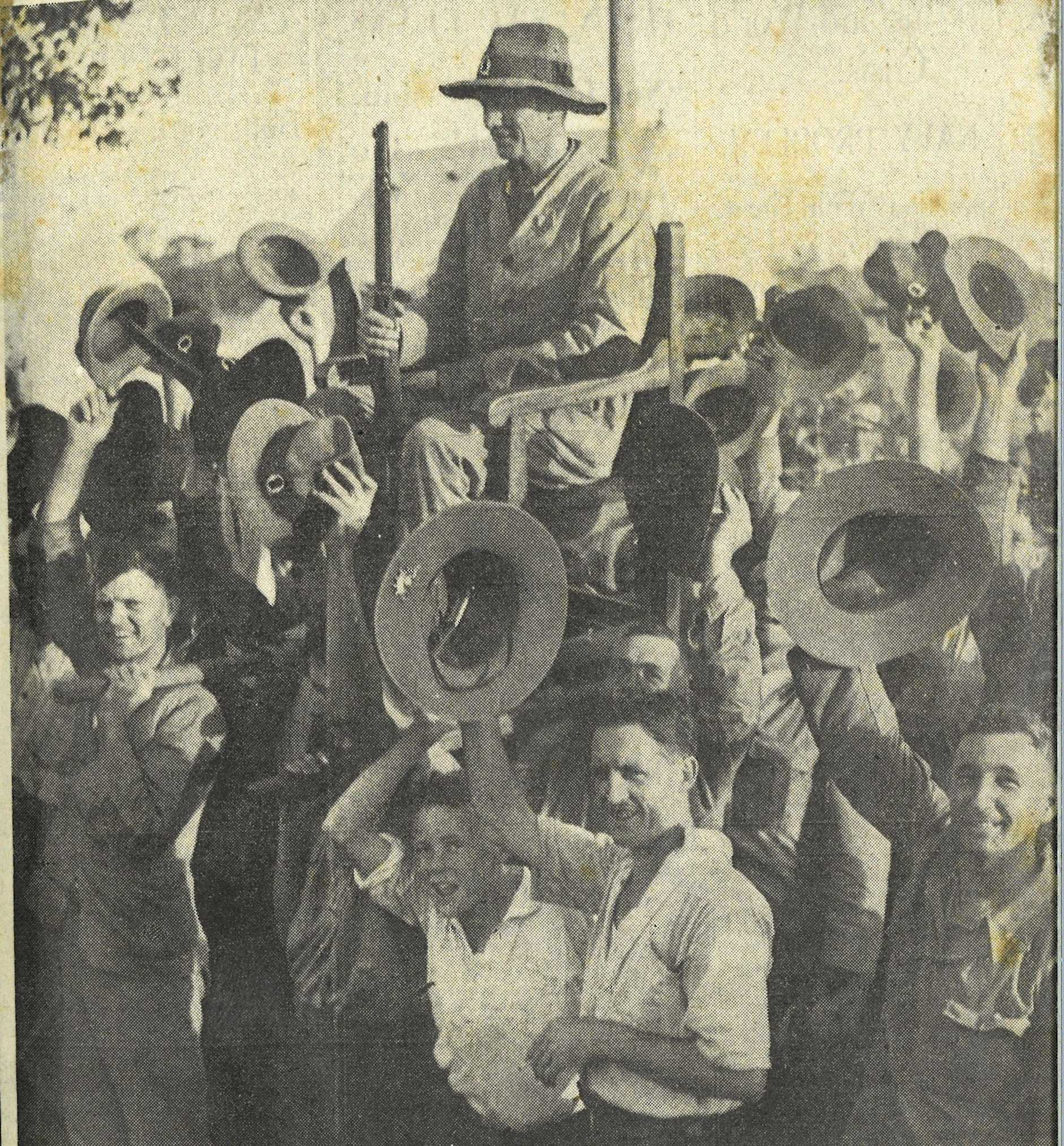 KING OF KINGS: Riflemen who competed at the Anzac Range, Liverpool, cheering Victor Roy Buttsworth, of Kingaroy as they performed the traditional chairing ceremony for the winner of the King's Prize. Buttsworth won the coveted prize with an aggregate of 347 points.