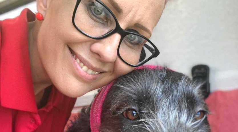 FURRY CUSTOMER: Belinda Hadley with dog wash client Odin.