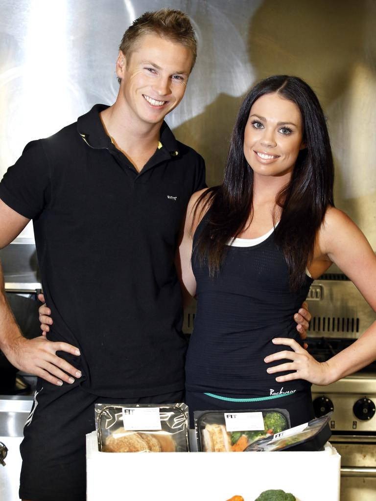 Business partners Lance Giles and Jordana Scott with some of the meals they sell in their company MyFit Fridge