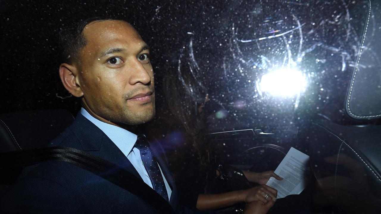 Folau leaves a Code of Conduct hearing in Sydney. Picture: AAP