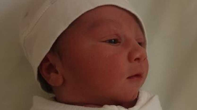 Baby Charles Arthur Sherwood was delivered in a car by his dad and an off-duty police officer.