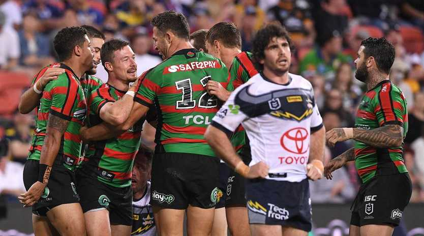 Damien Cook of the Rabbitohs (left) reacts after scoring a try during the Round 9 NRL match against the Cowboys at Suncorp Stadium in Brisbane, Sunday, May 12, 2019. (AAP Image/Dave Hunt) NO