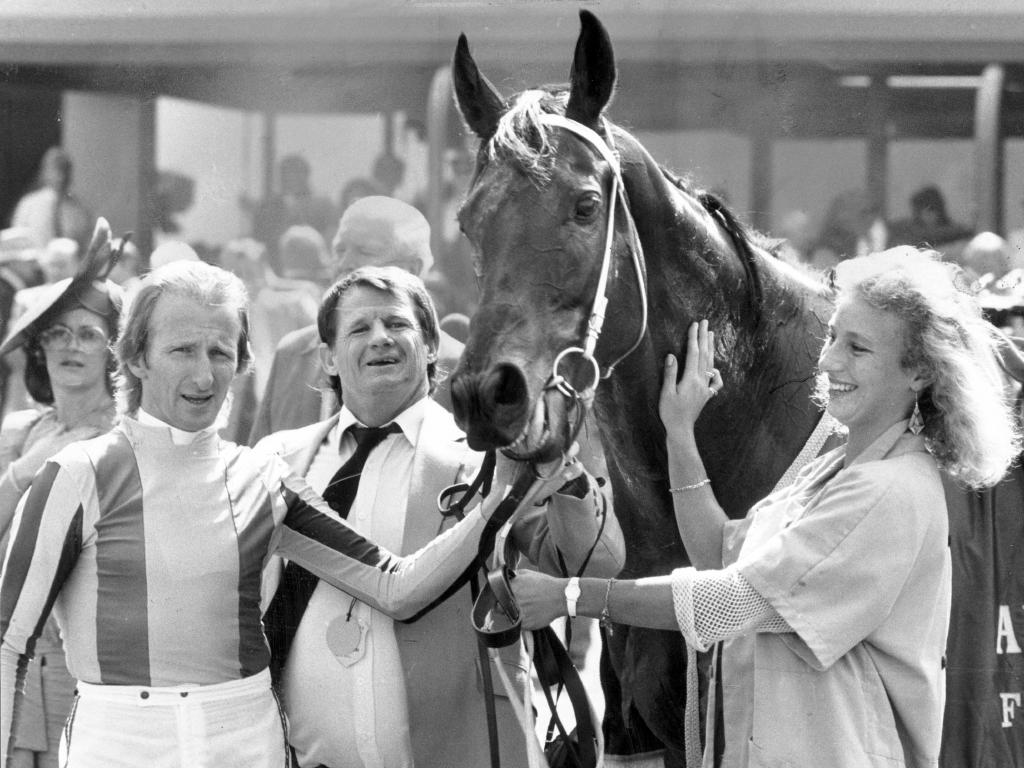 Jockey Cyril Small, (left) with trainer Vic Rail and strapper Lisa Simmons and Vo Rogue after winning at Flemington in 1989.