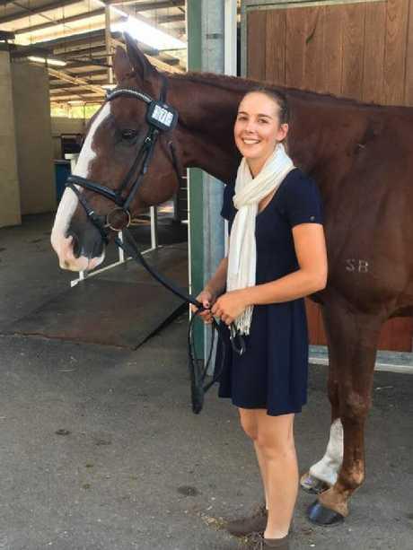 Caitlyn Fischer with her horse Ralphie.