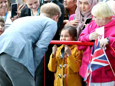 The Duke of Sussex talks to a little girl in the crowd. Picture:  Chris Jackson/Getty Images