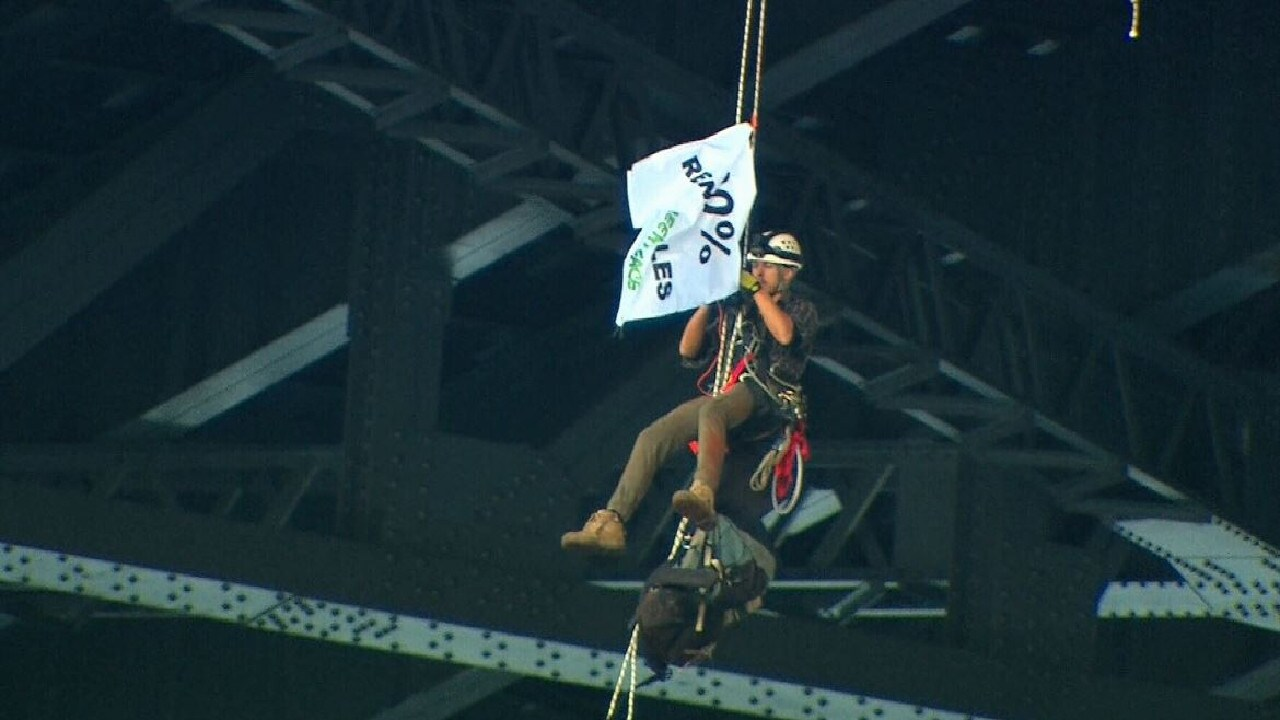 The banner appears to say '100% Renewables'. Source: Nine News