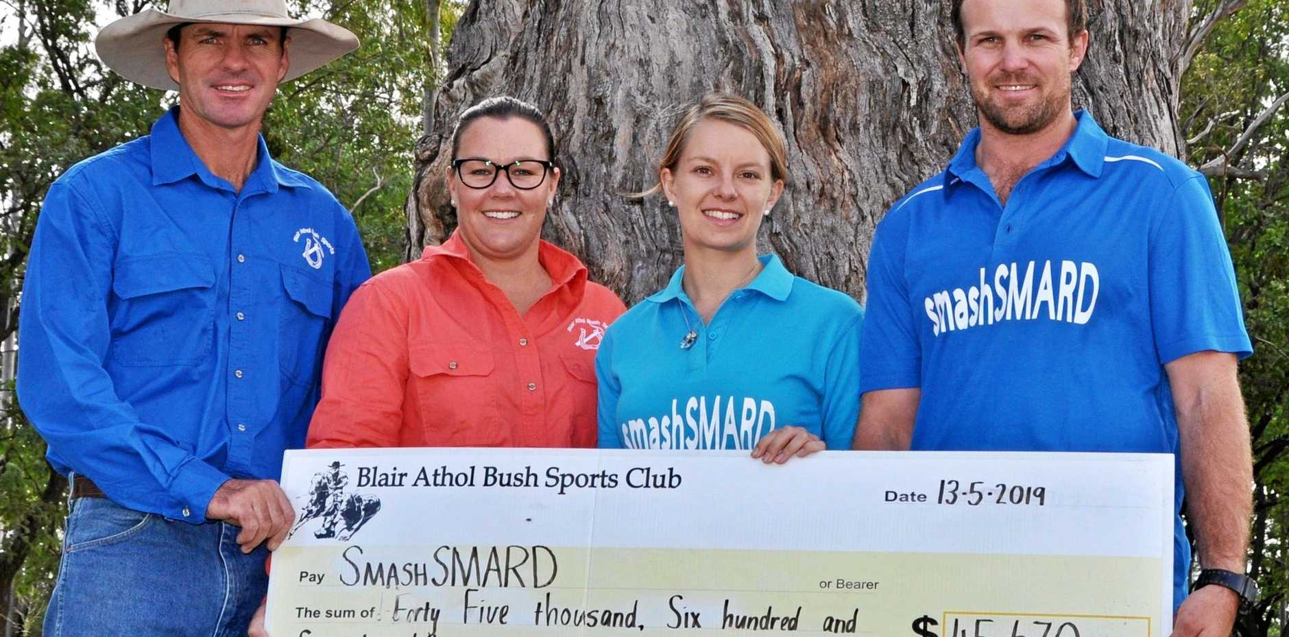 COMMUNITY GENEROSITY: Jeff Cook (President), Elise Lawrence (Treasurer) handing over a cheque to SmashSMARD representatives and fellow committee members Dean Williams & Crystal Watson.