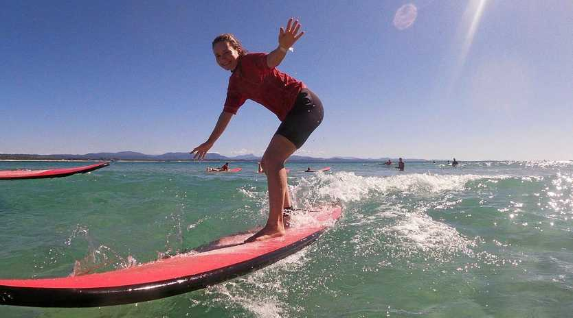 JUMP IN: Get on board with some surfing lessons.