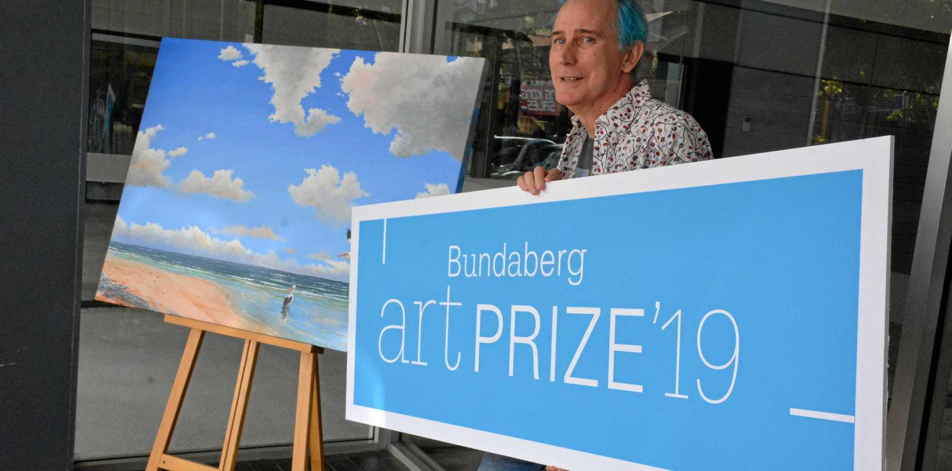 BIG BUCKS: Bundaberg Arts Festival president Phil Oakley announces the $10,000 prize for the winner of the 2019 Art Prize.