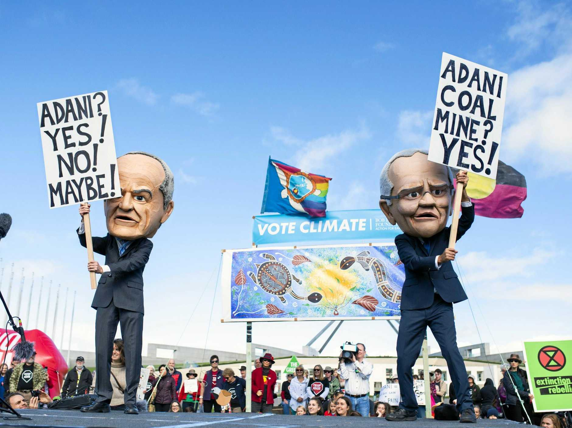 Protestors dressed as Scott Morrison and Bill Shorten during the anti-Adani Rally outside Parliament House in Canberra.