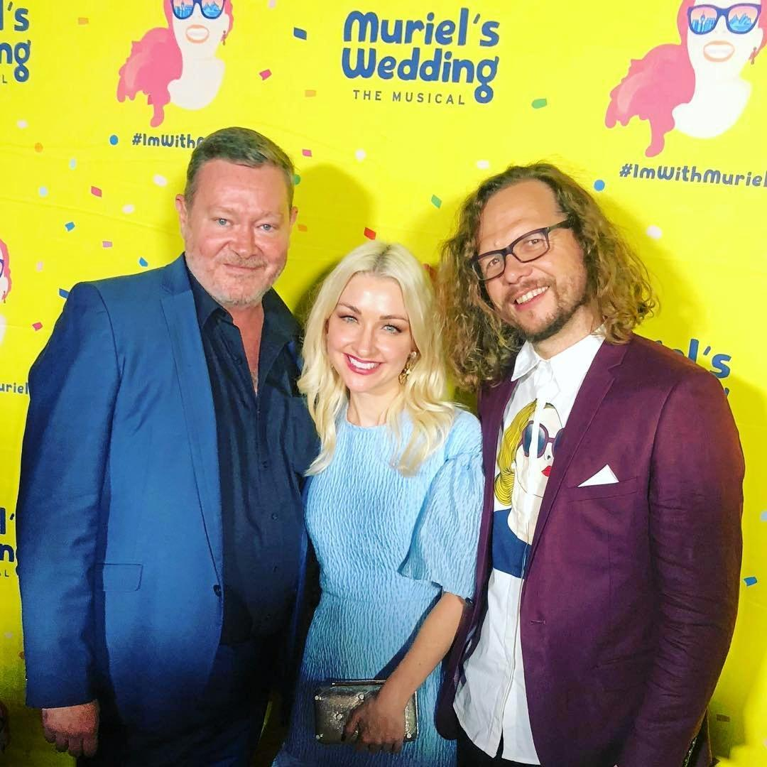 Agent to the stars, former Gladstone man Michael Montgomery with Kate Miller-Heidke and her husband Keir Nuttall at the opening of Muriel's Wedding in Sydney.