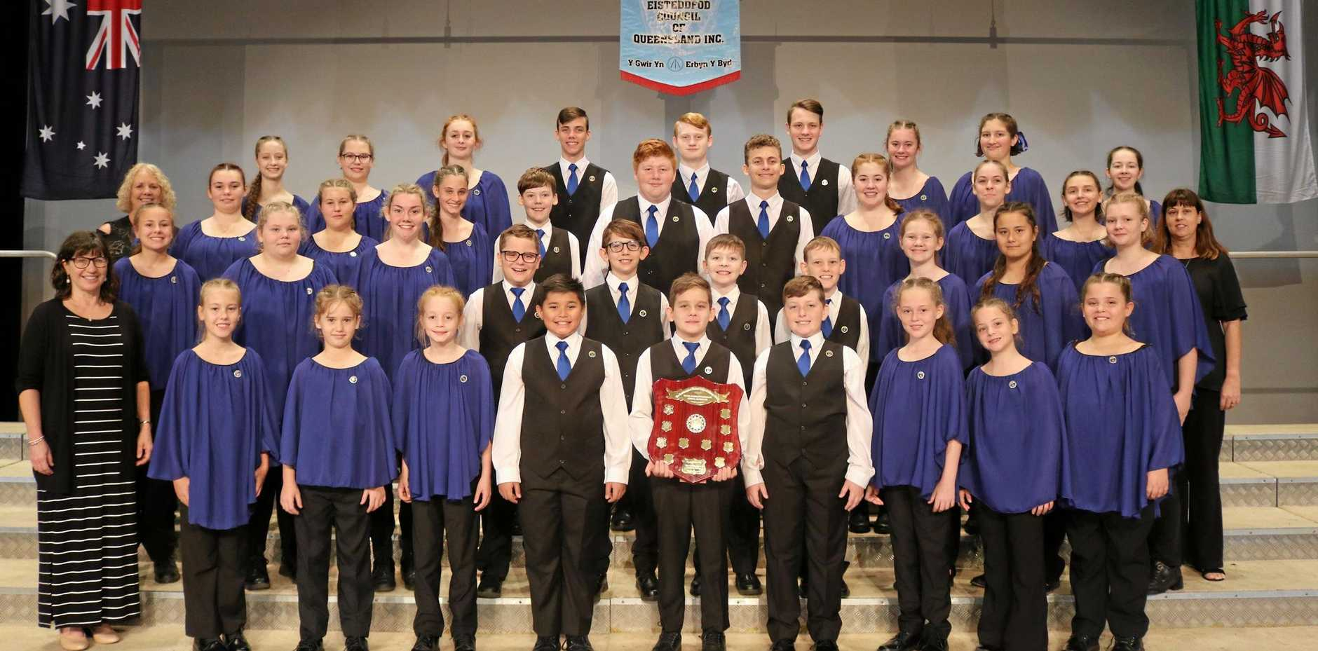 CHAMPIONS: The full choir including conductors Julie and Jodie and official accompanist, Anne Gralow.