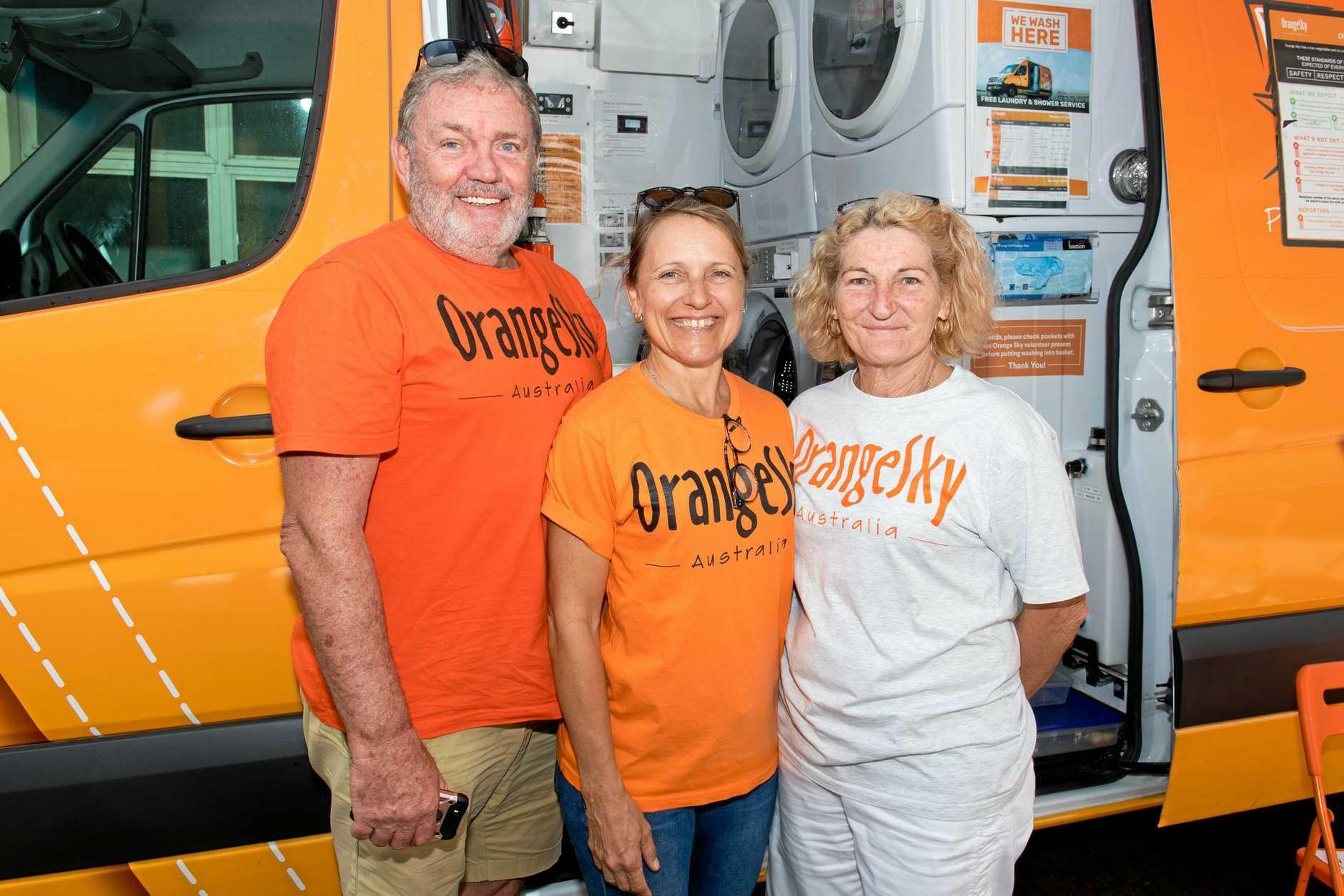 Noel White, Marilyn Bennett, and Valerie McBride from Orange Sky at the Homeless Services Expo on Wednesday.