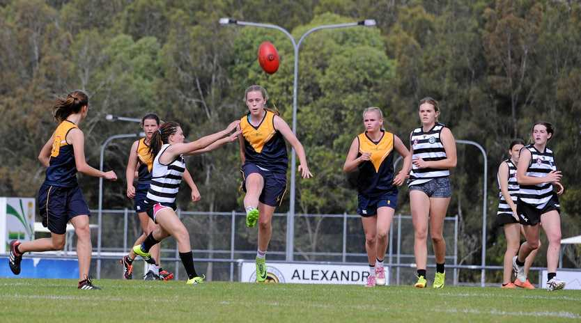 CUP STARS: Fairholme College's Claudia Ott punts the ball downfield during an AFL Queensland Schools Cup match last season. Fairholme made the final of the competition.