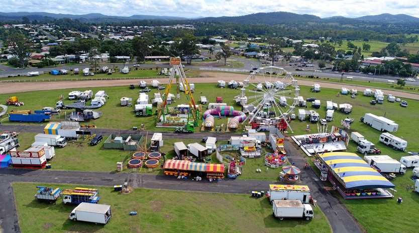 COMING TOGETHER: Exhibitors and sideshow alley operators set up at Gympie Showgrounds yesterday.