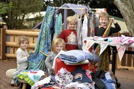 SECOND-HAND SALE: Helping get ready for the sale are (from left) Aria Nielsen, Lucy Rigby, Jethro Butel and Louis Peacey at the Vera Lacaze Memorial Community Kindergarten.