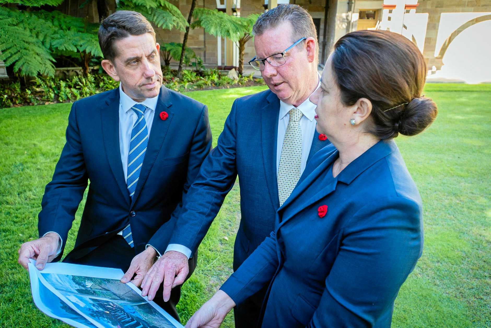 LEVEE READY: The Queensland Government's Minister Cameron Dick (left), Rockhampton Barry O'Rourke and Premier Annastacia Palaszczuk are ready to fast track the process of constructing the South Rockhampton flood levee.