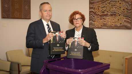 Labor Opposition leader Bill Shorten and Herbert MP Cathy O'Toole dumping Clive Palmer's book in the bin earlier this year. Mr Palmer had copies of the book sent to MPs and journalists in Canberra.