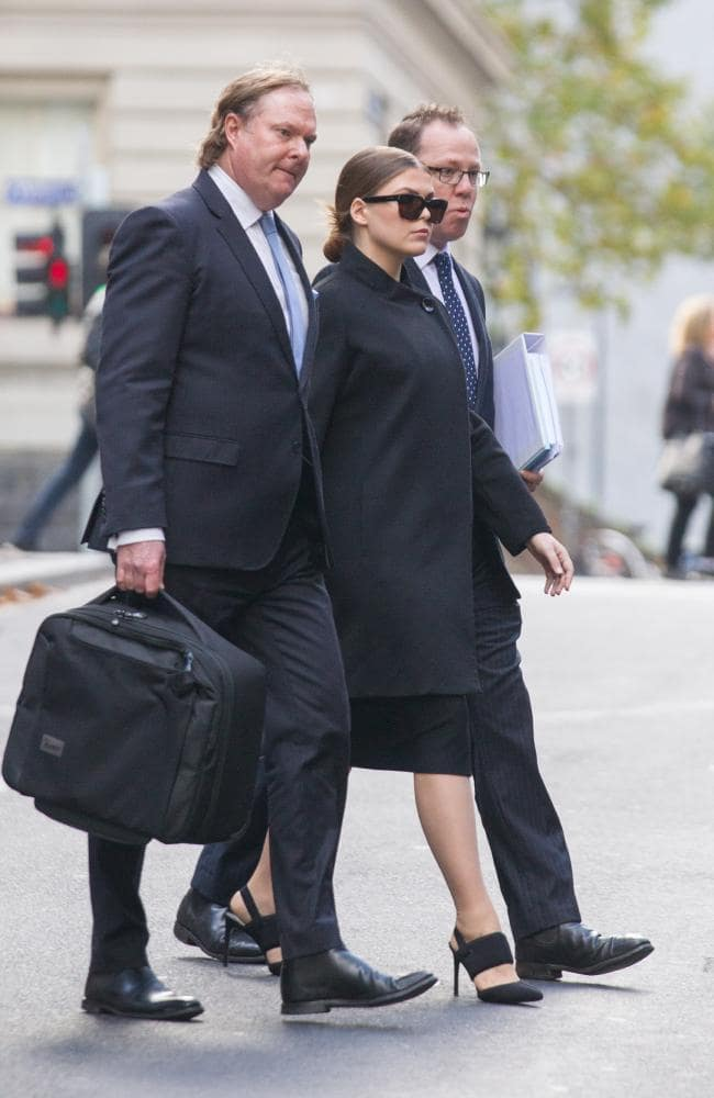 Belle Gibson pictured leaving court in Melbourne during a break in proceedings, accompanied by her lawyers. Picture: Matrix News