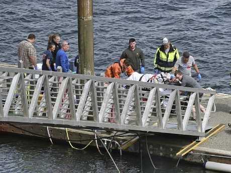 Emergency response crews transport an injured passenger to an ambulance at the George Inlet Lodge docks, in Ketchikan, Alaska. Picture: AP