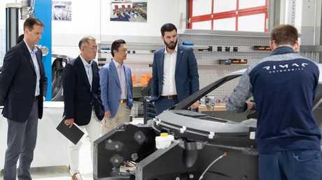 Hyundai executives with Mate Rimac.