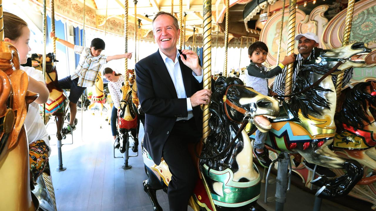 Shorten riding the carousel at Luna Park in Melbourne. Picture: Kym Smith
