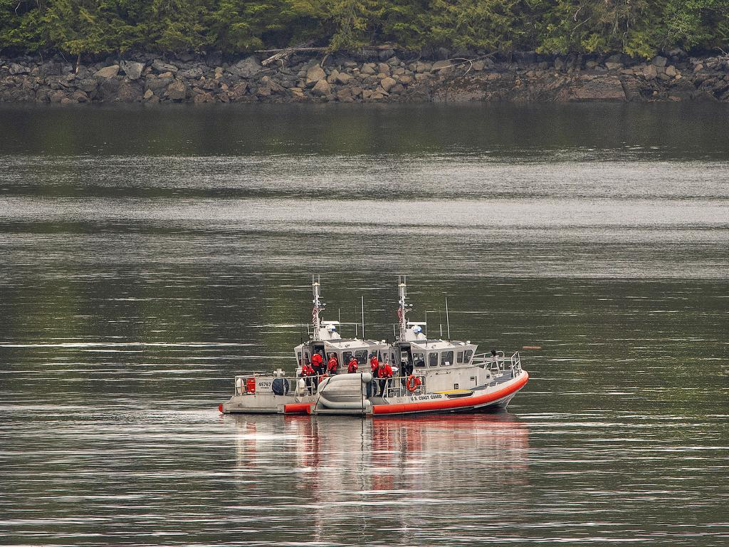 Two U.S. Coast Guard 45-foot response boats drift through George Inlet as part of a search effort. Picture: AP