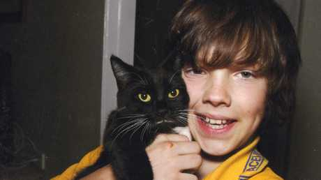 Josh with Kitty in 2011. His mother Ursula Wharton has created a heartbreaking video imploring Australian politicians to do more to help combat teen suicide.